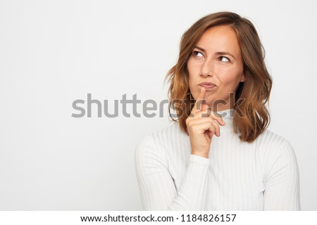 portrait of young woman thinking looks left  #1184826157