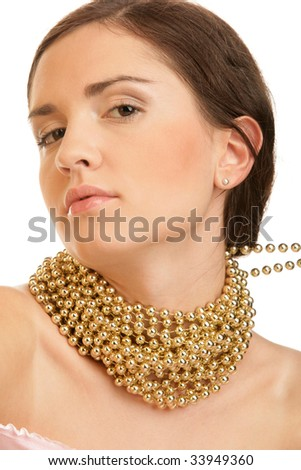 Portrait of young woman wearing golden necklace