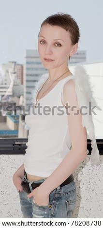 Portrait of young woman wearing wings
