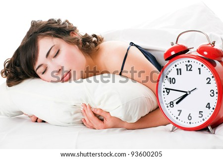 Portrait of young woman with alarm clock