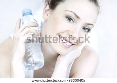 portrait of young woman with bottle