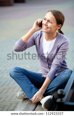 Portrait of young woman with cell phone outdoor