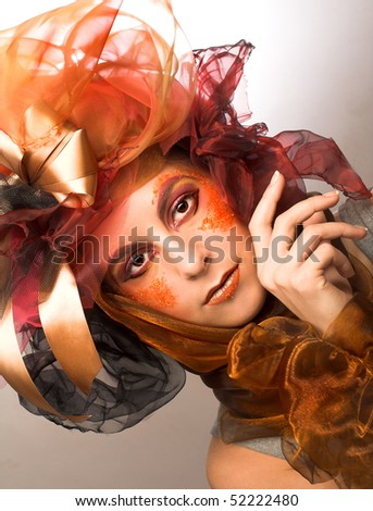 Portrait of young woman with creative make-up in doll style #52222480