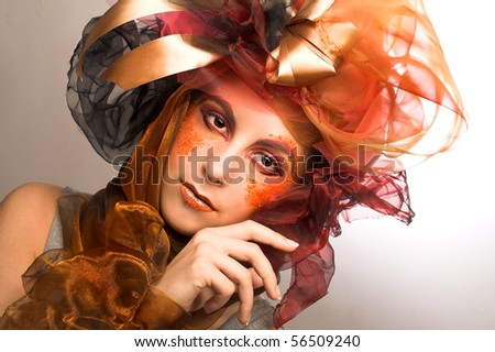 Portrait of young woman with creative make-up in doll style #56509240