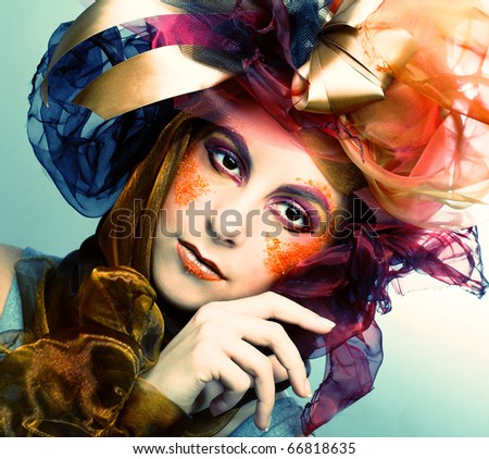 Portrait of young woman with creative make-up in doll style #66818635