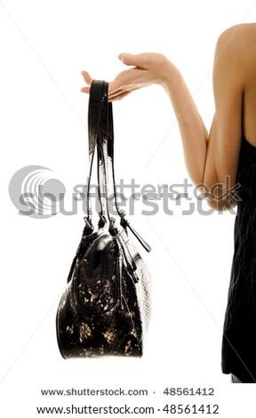 Portrait of young woman with dark handbag