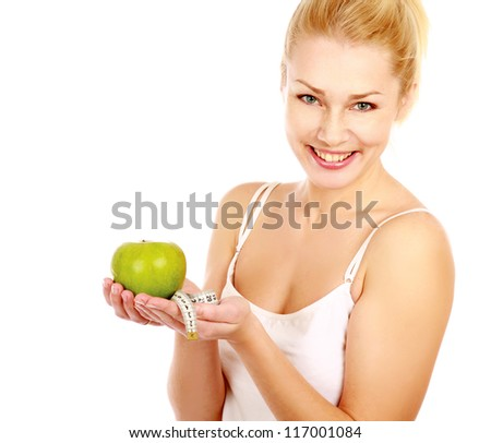 portrait of young woman with green apple and measure tape