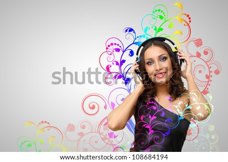 Portrait of young woman with headphones and glittering background