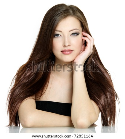 Portrait of young woman with long brown straight hair on white background