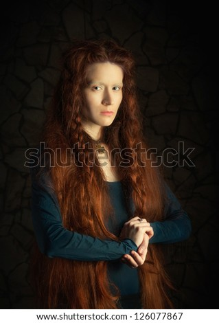 Portrait of young woman with long red hair. Image stylized as old picture
