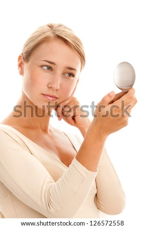 Portrait of young woman with mirror