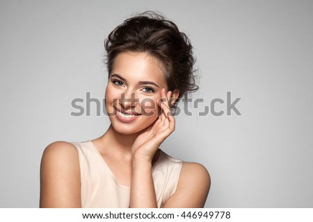 Portrait of young woman with perfect skin clean