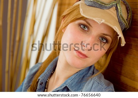 Portrait of young woman with pilot goggles