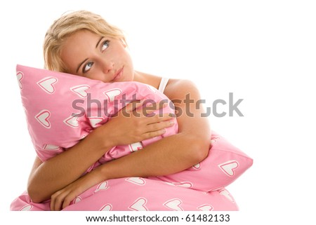 Portrait of young woman with pink pillow