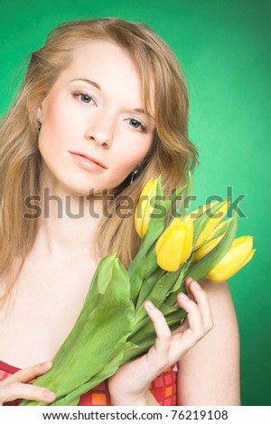 Portrait of young woman with yellow tulips #76219108