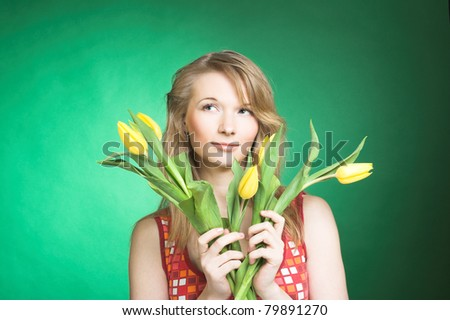 Portrait of young woman with yellow tulips #79891270