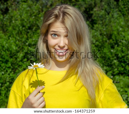 portrait of young wonder woman with camomile flower