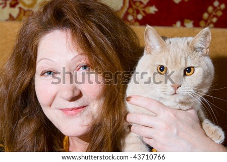 Portrait old woman and cat