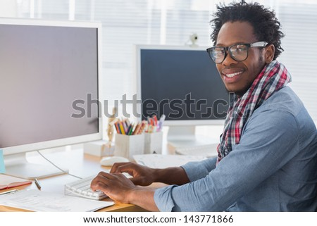 Portrait on a creative business worker on computer in a modern office