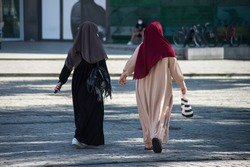 Portrait on back view of muslim women walking in the street