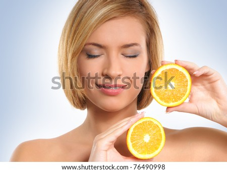 Portrait on young and healthy woman with orange  isolated on white