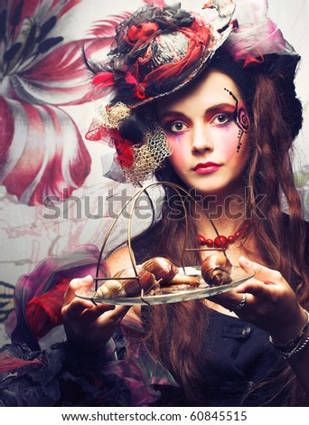 Portrait on young stylish woman with creative visage and with snails