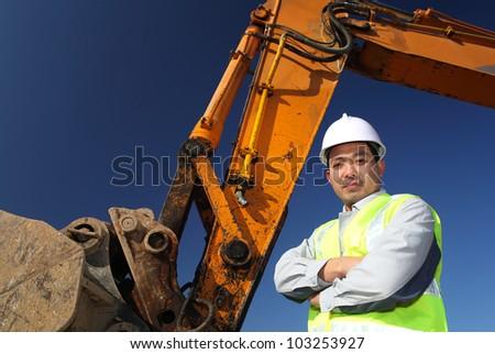 portrait operator of excavator standing on location site