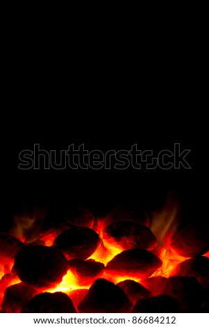 Portrait orientation of hot charcoal fire ready for barbecue with black copy-space