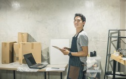 Portrait Owner In Warehouse. wholesale, logistic, people and export concept . Young man working warehouse.