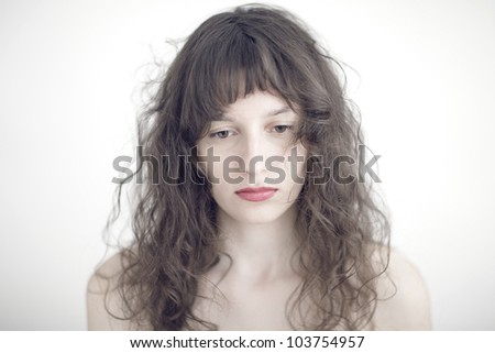 portrait photo of a sad and depressed young woman