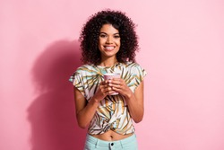 Portrait photo of black skinned pretty woman keeping mug with hot drink smiling isolated on pastel pink color background