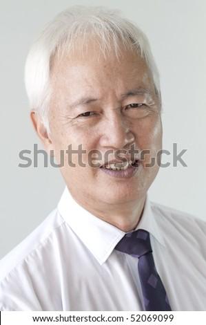 portrait photo of old senior asian business man smiling