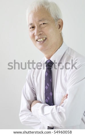 portrait photo of smiling old asian ethinicity business man
