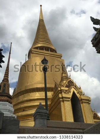 Portrait pic of golden Thai Temple building in Bangkok temple.