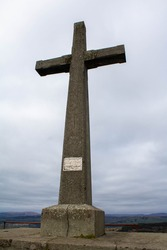 Portrait picture of a Celtic cross on top of a mountain in west Cork Ireland