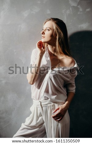 Portrait portrait lady in white wear.Glamour fashion style catalog casual clothes for woman with natural make up of her perfect body. Model suit