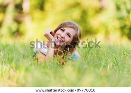 portrait pretty young woman lying grass resting background summer meadow green grass forest