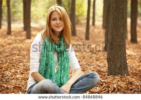 Portrait redhead girl at outdoor. Autumn. - stock photo