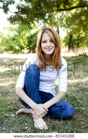 Portrait redhead girl at outdoor. Autumn. #85545388