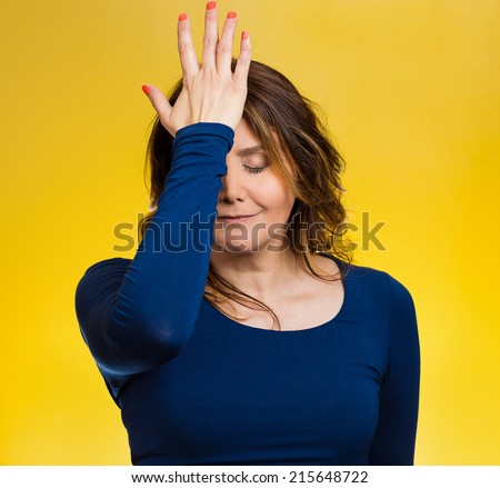 Portrait sad middle aged woman realizes mistake, regrets, slapping hand on head to say duh, isolated yellow background. Negative emotions, facial expression, feelings, body language, reaction Сток-фото ©