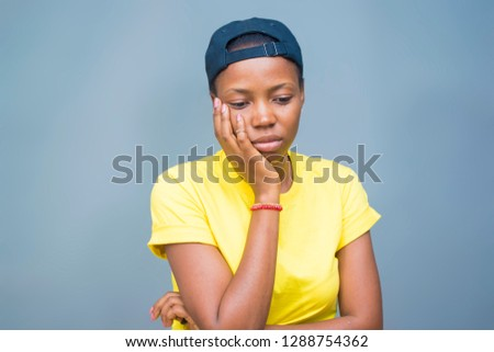 portrait sad unhappy African woman isolated on Gray background