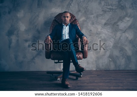 Portrait serious focused chairman boss executive manger cool confident sit brown furniture dream dreamy short hair bald entrepreneur crossed legs wear jackets trousers shoes isolated grey background Foto stock ©