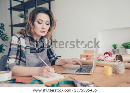 Portrait serious focused vendor use modern technology gadget make orders bouquets bunches plan holiday 8-mrach consumerism floral natural nature wavy curly haircut trendy stylish shirt plaid indoors