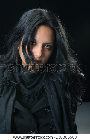 Portrait serious gypsy woman over black background