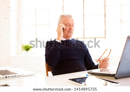 Gray Haired Executive Businessman Working On Laptop Computer
