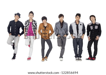 Portrait shot of group of friends in casual wear posing over plain white background.