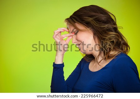 Portrait side view profile headshot of stressed housewife middle aged woman with headache isolated on green background. Human face expressions, emotions, feelings, life perception