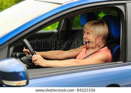 portrait  smiling young woman in the car