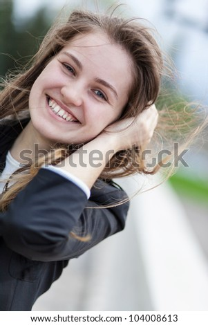 Portrait smiling young woman outdoors