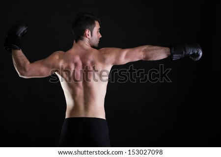 Portrait sportsman boxer in studio against dark background